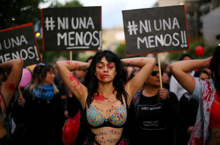 """A demonstrator depicting lacerations is seen during a peaceful march against the gender violence in Santiago, Chile, October 19, 2016. The posters reads """"Not one less!"""". REUTERS/Ivan Alvarado"""